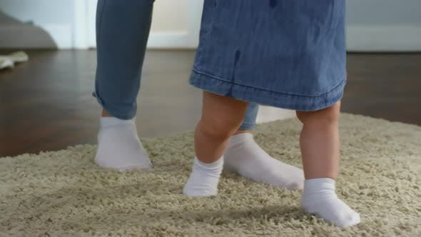 Thumbnail for Baby Girl Walking with Mother's Support