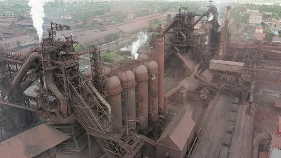 Epic Aerial of Pipes with White Smoke Emission. Plant Pipes Pollute Atmosphere. Industrial Factory