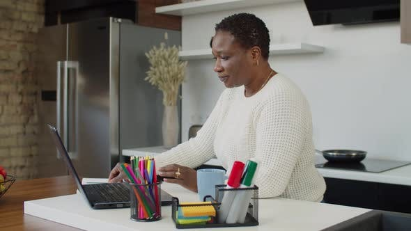 African Female Freelancer Working Remotely at Home