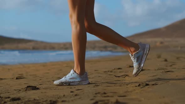 Thumbnail for Close-up Shot of a Woman in White Sneakers Walking on Beach, Beautiful White Sand. SLOW MOTION
