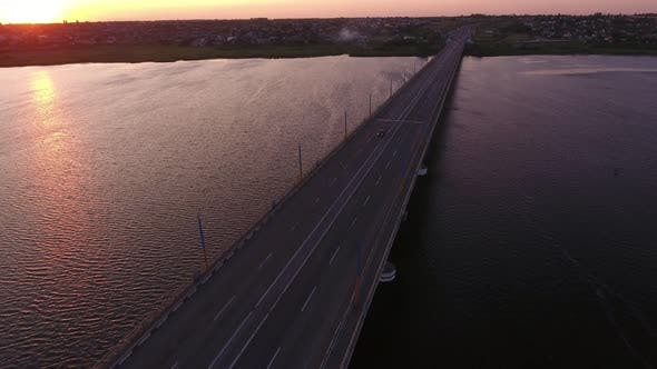Thumbnail for Aerial Shot of a Lofty Bridge Over the Dnipro at a Violet Sunset in Summer