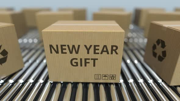 Carton Boxes with NEW YEAR GIFT Text Move on Conveyor