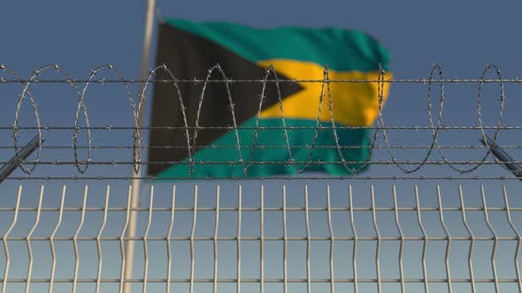 Thumbnail for Flying Flag of Bahamas Behind Barbed Wire Fence