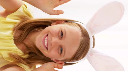 Girl in Easter Bunny Ears Playing Peek a Boo Game