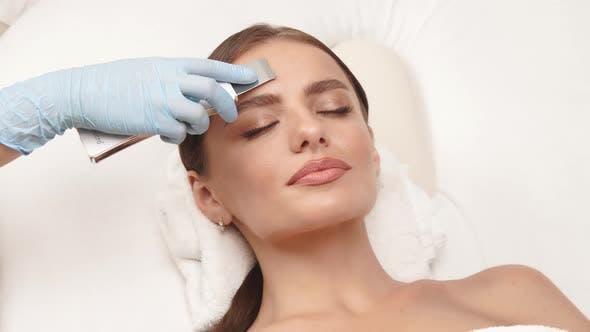 Lovely Woman Having Treatment on Forehead
