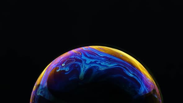 Thumbnail for Multicolored Rainbow Colors of a Single Soap Bubble That Looks Like a Fantasy Planet Isolated