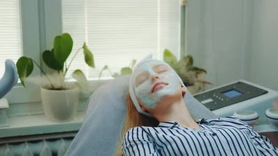 Professional Facial Skin Care Treatment with a Cosmetic Steamer at Beauty Salon