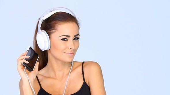 Thumbnail for Sweet Girl Listening To Music On Headphones