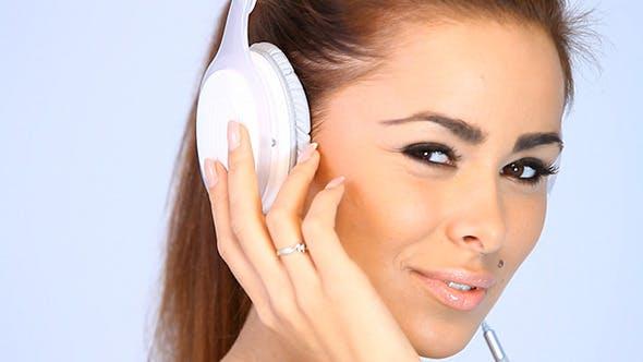 Thumbnail for Pretty Girl Listens To Music on Headphones