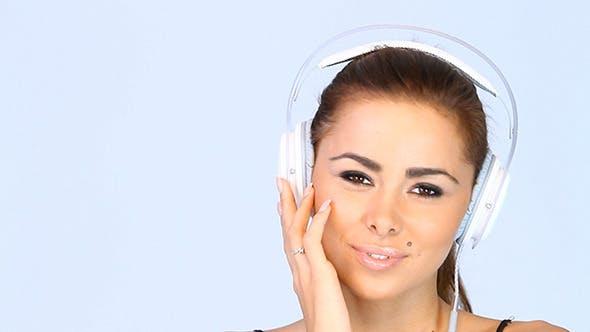 Thumbnail for Girl Listening To Music On Her Headphones