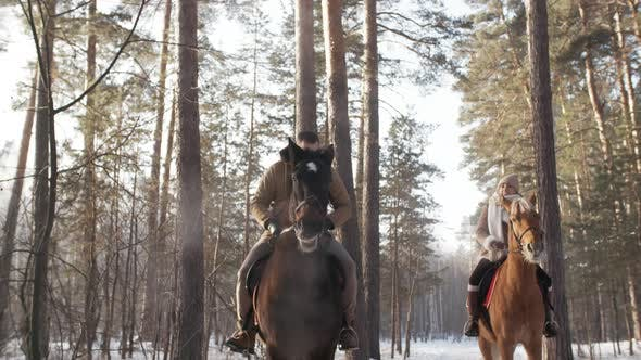 Thumbnail for Caucasian Couple Enjoying Horseback Riding on Winter Day