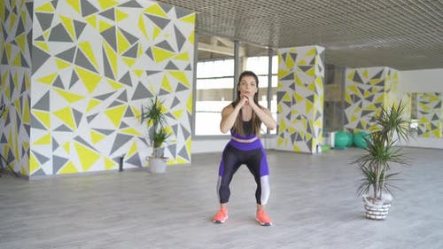 Young Fit Woman Doing Jumping Squats