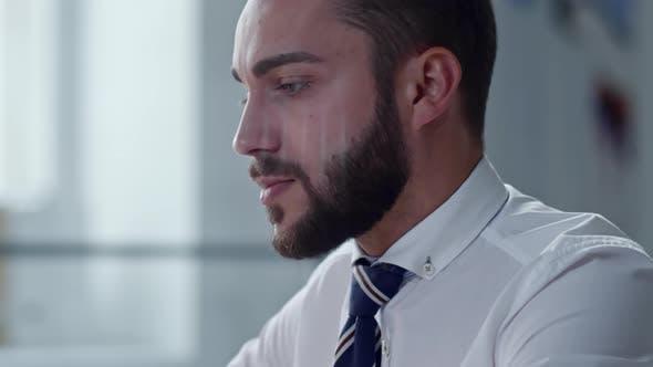 Thumbnail for Handsome Entrepreneur Video Calling on Laptop