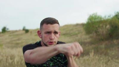 Strong Boxers Training Kicks on Nature at Camera