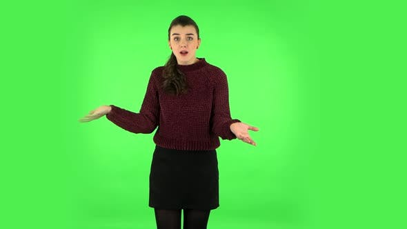 Thumbnail for Displeased Woman Indignantly Talking To Someone, Looking at the Camera. Green Screen