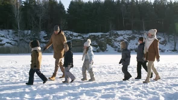 Thumbnail for Happy Family Hiking Across Frozen Lake