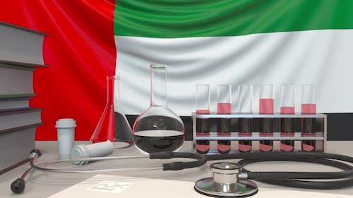 Laboratory Equipment on the UAE Flag Background