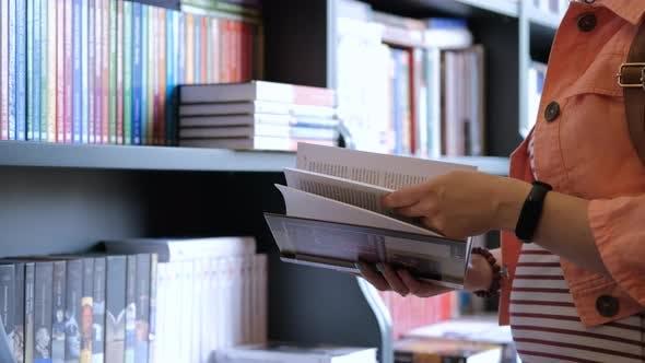 Closeup of Woman Customer Shopping in a Bookstore