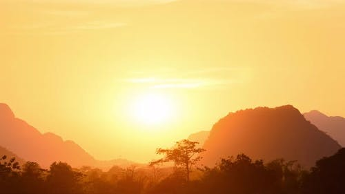 Panorama golden sunset over scenic cliffs and rock pinnacles, rainforest silhoue
