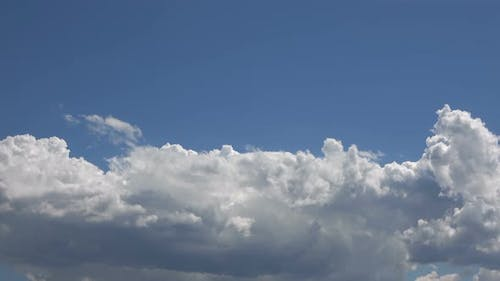 White Rain Clouds And Blue Sky