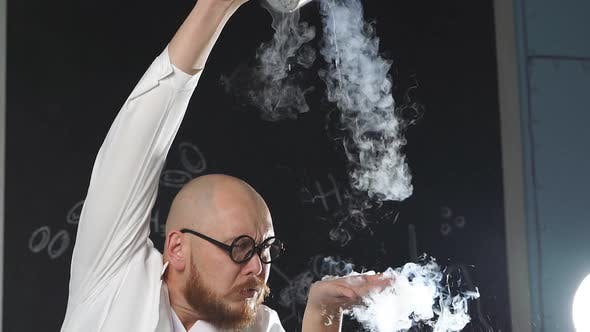 An Amazing Chemist Showing Experiments Uses Liquid Nitrogen He Pours It on His Hands and It Turns