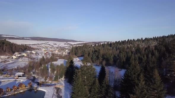 Thumbnail for Aerial View of Winter Landscape with Snowy Hills and Trees