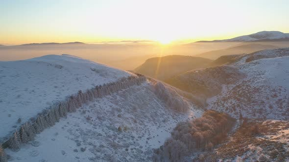 Thumbnail for Mountain Road at Sunset. Landscape of Misty Snowy Mountains at Sunset