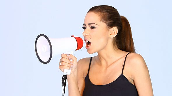 Young Woman Screaming Into a Megaphone
