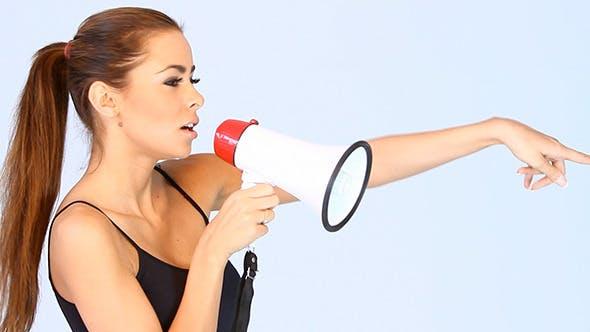 Thumbnail for Beautiful Woman Yelling Through a Megaphone