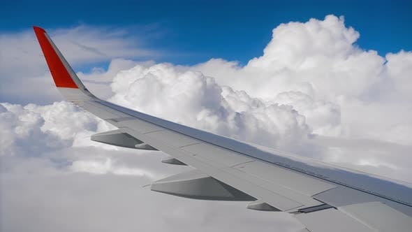 Thumbnail for Wing of Airplane on Sky and Cloud on Moving