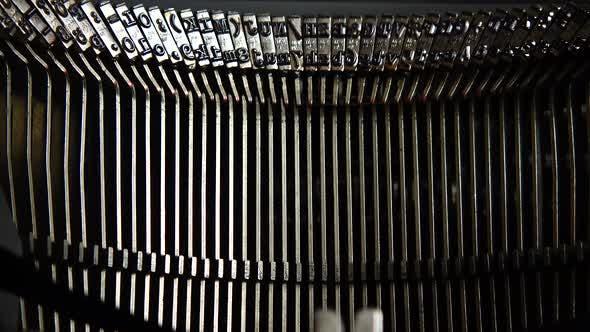 Mechanism of a retro typewriter. Old typewriter hammers. Close up.