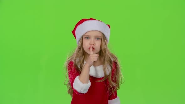 Thumbnail for Child Girl of the Assistant Santa Claus Say Quietly To Their Elves. Green Screen