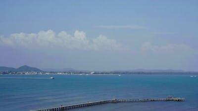 panning shot of Wooden bridge to the sea at Rayong,Thailand