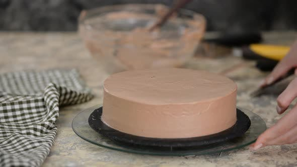 Thumbnail for Pastry chef finish decorating the cake with chocolate cream