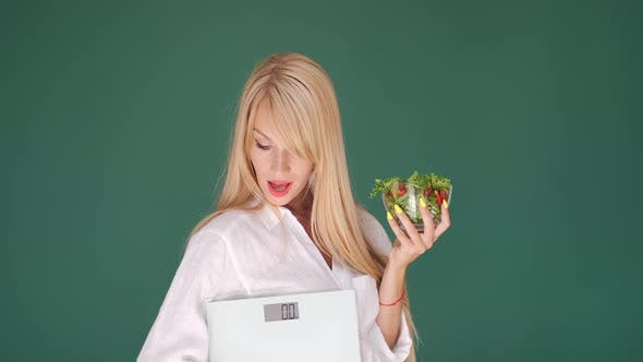 Thumbnail for Beatiful Dietitian with Scales and Bowl of Salad on Green Background