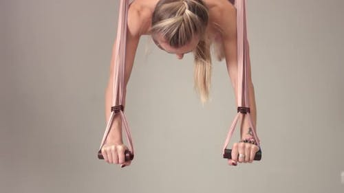 Adorable Woman Yoga Trainer During Aerial Yoga Master Class