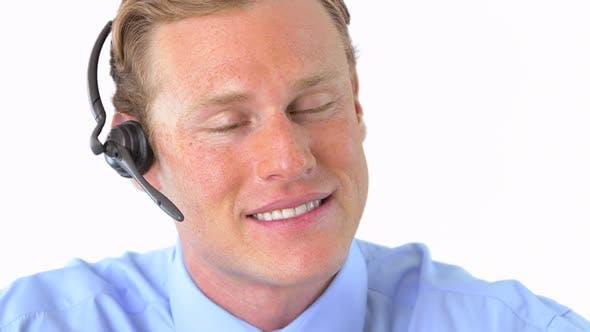 Thumbnail for businessman talking on headset