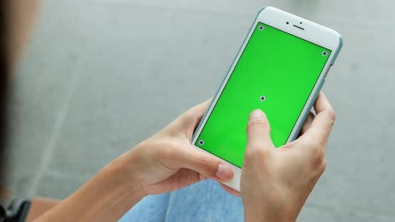 Thumbnail for Woman holding smartphone in the hands of a green screen green screen