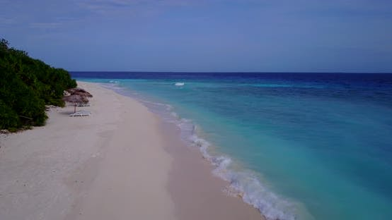 Thumbnail for Wide angle fly over abstract shot of a sunshine white sandy paradise beach and aqua blue ocean backg