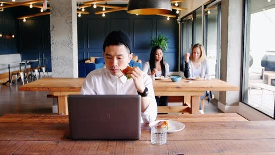Thumbnail for Businessman using laptop in cafeteria at office 4k