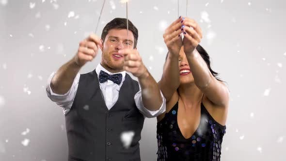 Thumbnail for Couple with Sparklers Dancing at Christmas Party