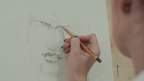Concentrated Woman Artist Painting Classical Man Portrait with Pencil