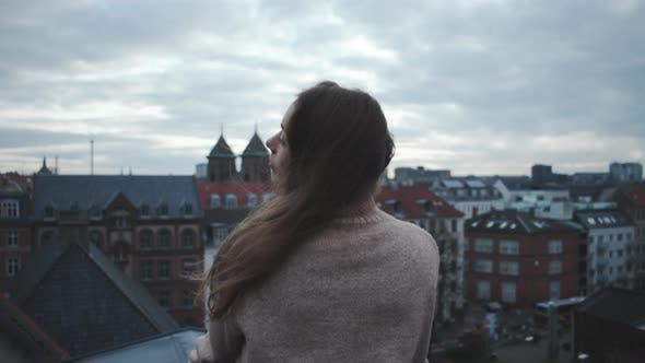 Thumbnail for Brunette Looking Over City