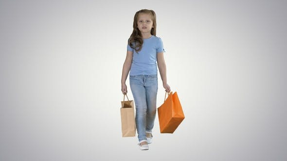 Thumbnail for Little Girl with Shopping Bags Walking on Gradient Background