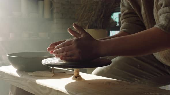 Potter Is Shaping Clay On Potter's Wheel