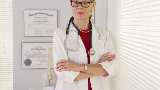 Thumbnail for Experienced senior woman doctor standing