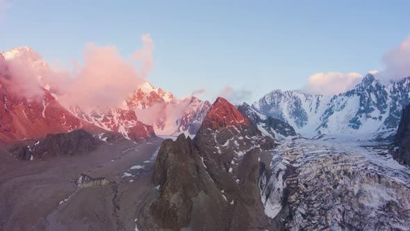 Thumbnail for Tian Shan Snow-Capped Mountains at Sunset. Aerial Hyper Lapse
