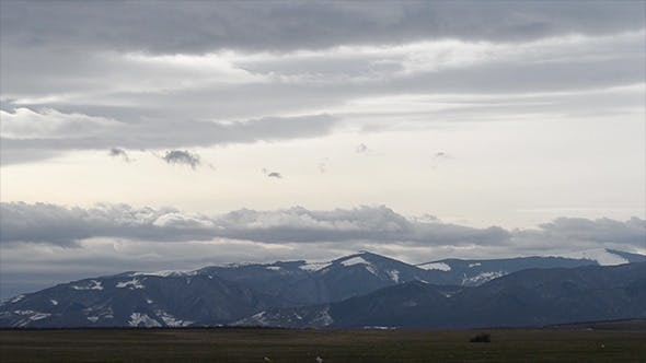 Thumbnail for Grey Clouds Over Snowy Mountains Time Lapse