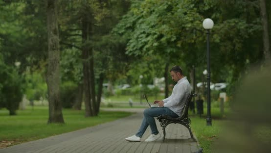 Thumbnail for Freelancer With Laptop In The Park