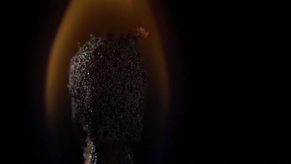 Thumbnail for Match Instantly Lights Up and Goes Out. Slow Motion. Black Background. Close Up